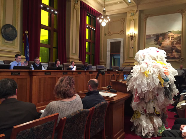 Steve Eberly, a member of Linden Hills Power & Light, dressed as a plastic bag monster during Monday's public hearing at City Hall on the proposed ban on single-use plastic carryout bags.