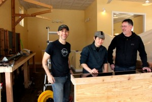 Scott Ronken, Cayley Baird and owner Greg Neis (l to r) at Farmstead Bike Shop, opening in April at 4001 Bryant Ave. S. Photo by Michelle Bruch