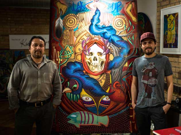 Gustavo Lira Garcia and Rodrigo Onate Roco with their new collaborative piece on sale during Art-A-Whirl. Photo by Ryan Stopera