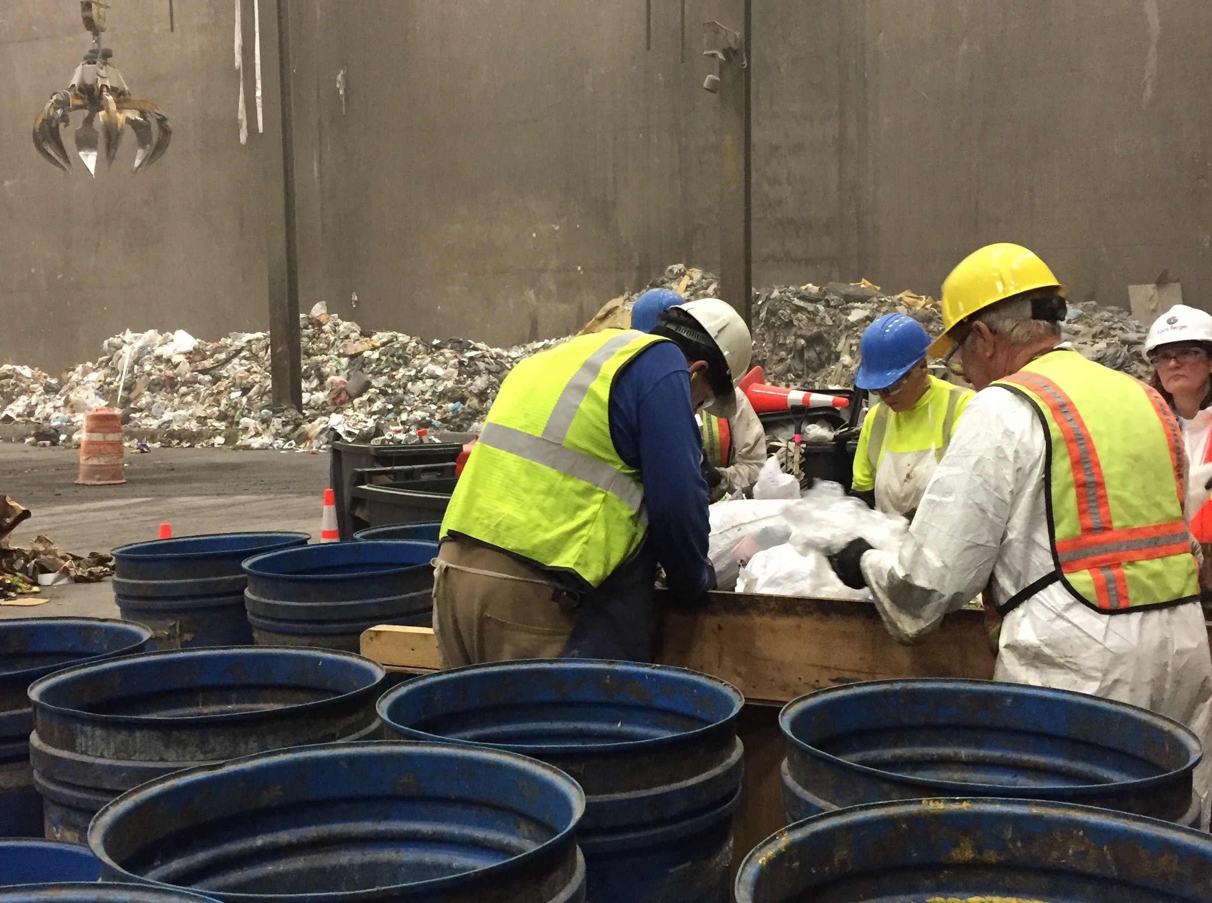 Workers sort through trash this past May at the HERC as part of Hennepin County waste-sort study. Photo by Sarah McKenzie