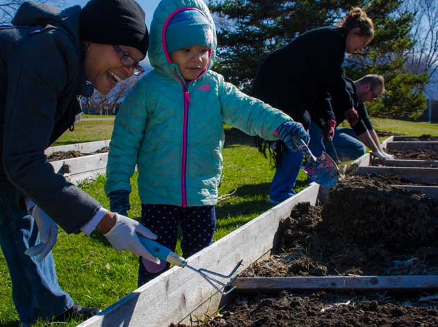 "Volunteers take classes in gardening at Rev. Dr. Martin Luther King Jr. Park, with produce in the ""donation garden"" given to The Aliveness Project. Submitted photo"