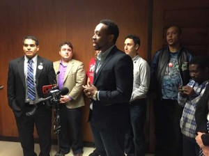Ron Harris, a community organizer with Neighborhoods Organizing for Change, discusses his support for the proposed sick time ordinance Thursday morning at City Hall. Photo by Sarah McKenzie