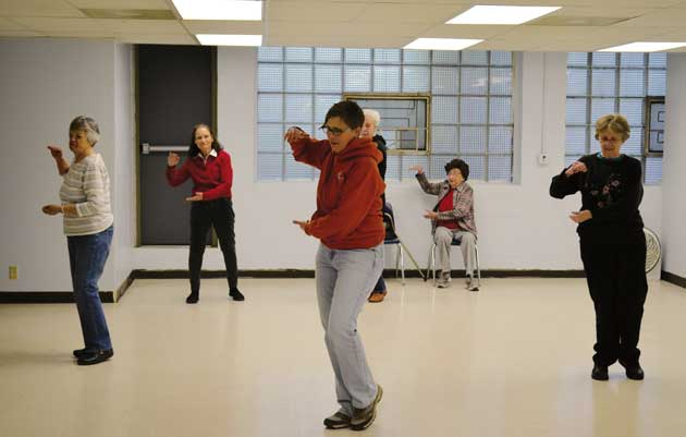 Lucinda Naylor leads Tai Chi class at the Southwest Senior Center, a Minneapolis nonprofit that offers a variety of services from meals to exercise classes for people 50 and older. Photo by Nate Gotlieb