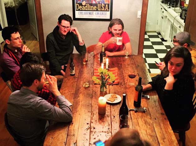 Tane Danger and Eric Roper enjoy their new table with friends.