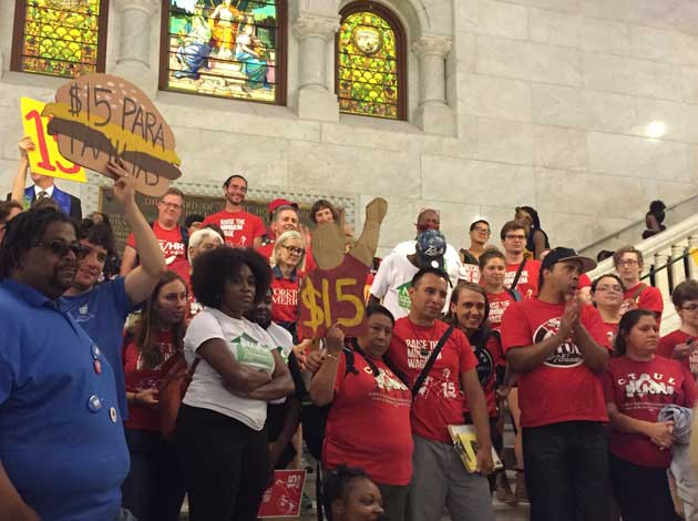 Workers rally in City Hall in support of raising the minimum wage in Minneapolis to $15 an hour. Photo by Sarah McKenzie
