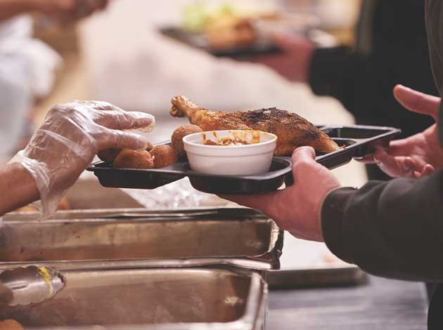 The average lunchtime brings hundreds of diners to House of Charity's food center, which serves free public meals 365 days a year. Photo courtesy of House of Charity