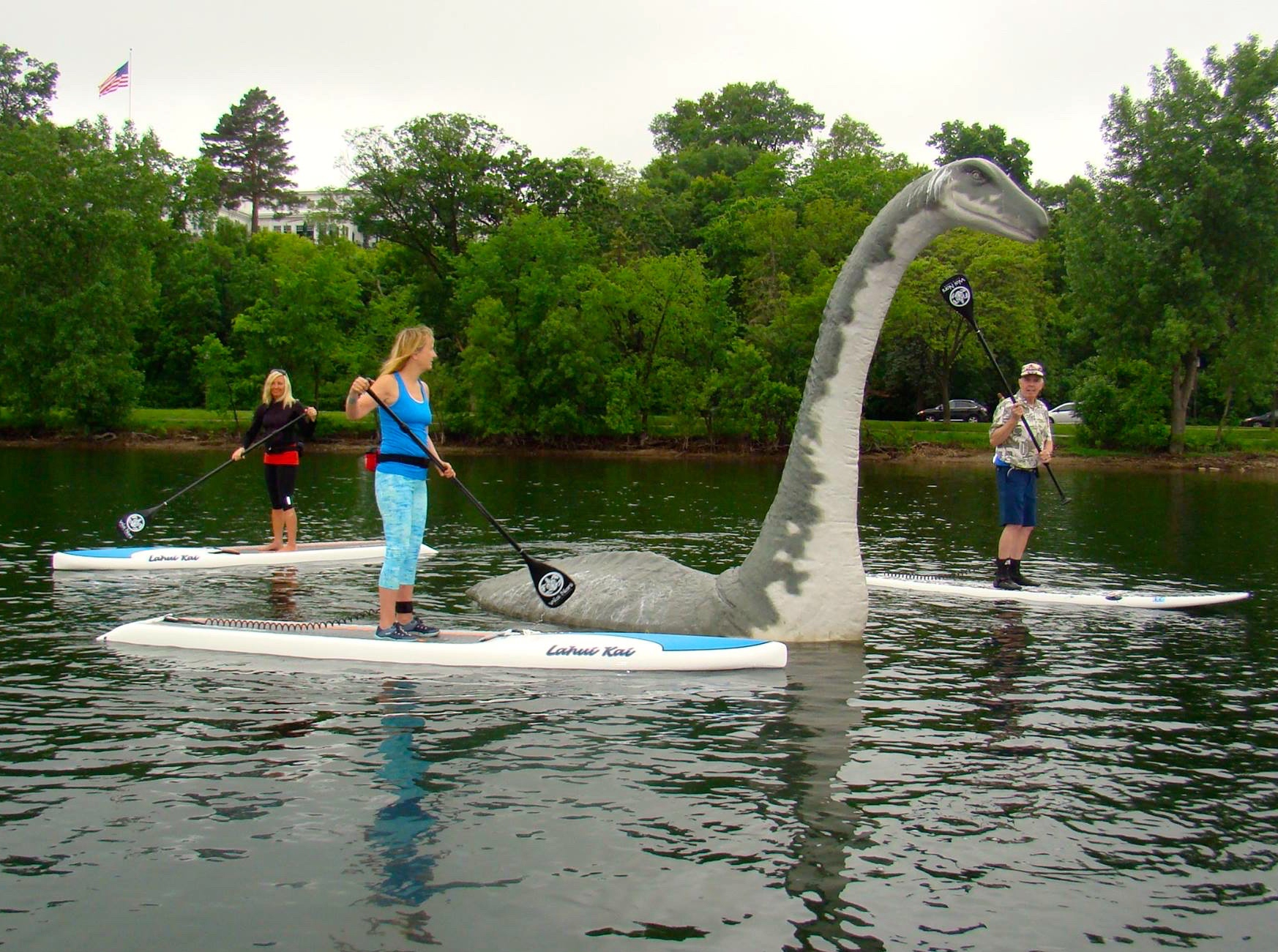 Paddleboarders visited Minne the Lake Creature in Lake Calhoun. File photo