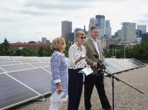 (From left) Park Board Commissioner Anita Tabb, Park Superintendent Jayne Miller and Lee Gabler of Xcel Energy next to Parade Ice Garden's new solar array. Photo courtesy of the Minneapolis Park and Recreation Board