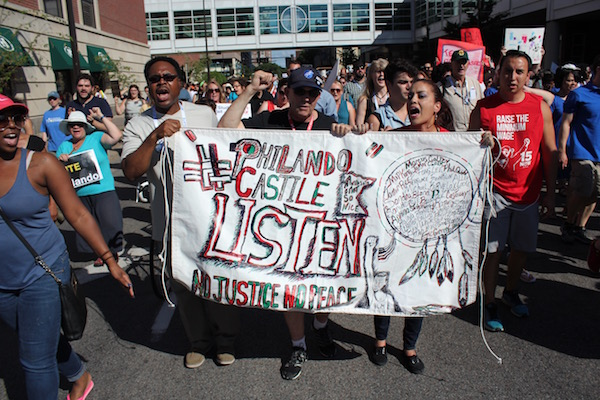 Protesters carried a banner honoring Philando Castile, a St. Paul schools employee shot and killed by a St. Anthony police officer.