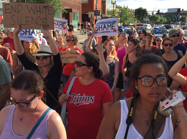 Marchers on Hennepin on Saturday. Photo by Sarah McKenzie