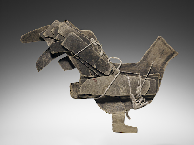 James Castle constructed this undated gray bird from torn cardboard and paper, cotton string, soot and other found materials.