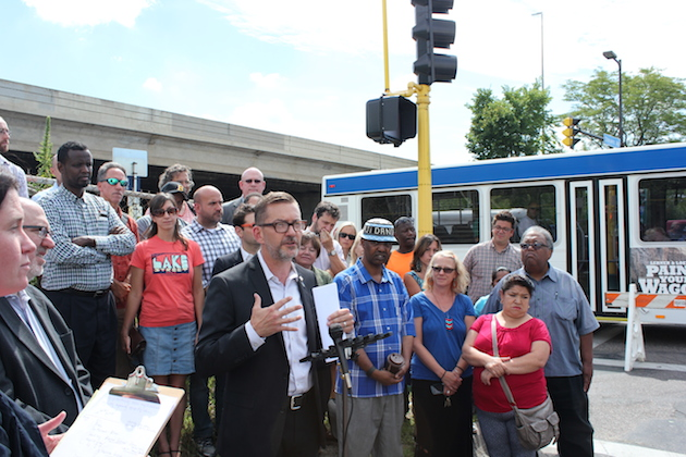 State Sen. Scott Dibble spoke Monday at a rally in support of Orange Line bus rapid transit.