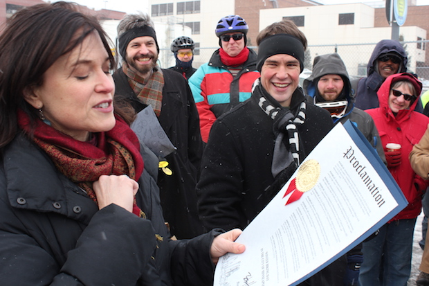 Minneapolis Bicycle Coalition Executive Director Ethan Fawley looked on as Mayor Betsy Hodges declared Winter Biking Day in 2014. File photo