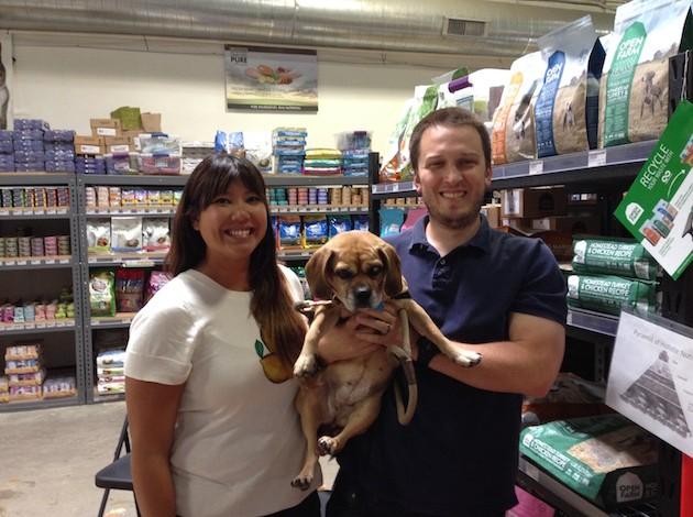 Minneapolis resident Marie Chaiart and her husband, Marlon Masanz, smile with their half beagle, half pug, Holly, on an August afternoon at Urban Tails Pet Supply. The couple adopted the terminally ill Holly through the Minneapolis nonprofit Pet Project Rescue, which operates a hospice-foster program. Photo by Nate Gotlieb