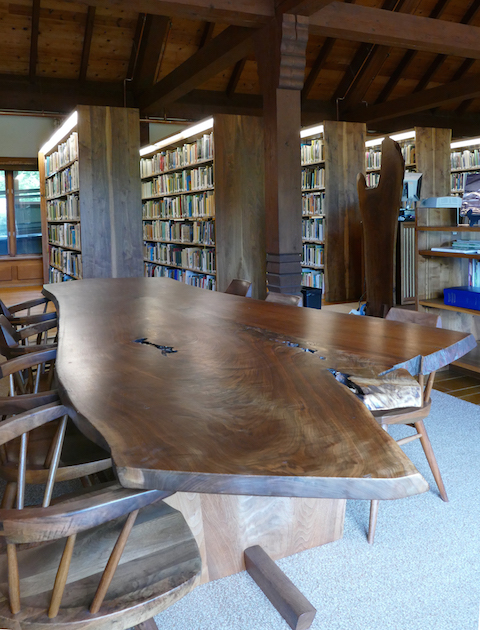 Tables and chairs by George Nakashima show beautiful grain and natural edges of the original trees.