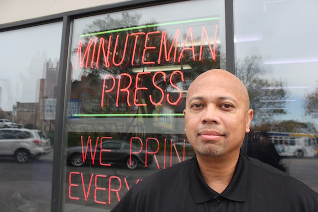 While many business owners responded skeptically to a city minimum wage study, Minuteman Press franchisee Frank Brown said starting employees at $15 has been good for business. Photo by Dylan Thomas