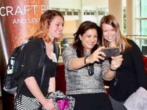 University of Minnesota Girls Who Code club leaders Morgan Meissner (left) and Ashley Arthur (right) take a selfie with the organization's founder, Reshma Saujani (center), after her talk at an Achieve Minneapolis luncheon last month.