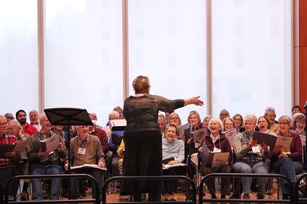 Choral director Jeanie Brindley-Barnett leads the Giving Voice Chorus through a rehearsal at MacPhail Center for Music. Photo by Dylan Thomas