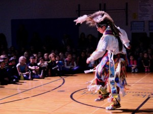 Shawnii Legarde, 15, of the Niiwo Giizhik Dance Troupe performs a traditional Native American dance during an assembly at Lake Harriet Upper School. Photo by Nate Gotlieb
