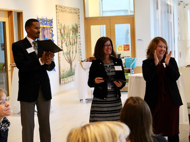Minneapolis chief of schools Michael Thomas, Field Community School principal VaNita Miller and Swedish principal Lisa Landerhjelm congratulate members of the Minneapolis-Uppsala exchange program during a program at the American Swedish Institute. Photo by Nate Gotlieb