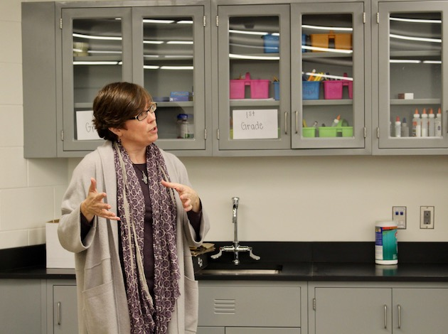 Webster Elementary School principal Ginger Davis Kranz shows off the school's project lab during a Nov. 7 tour as part of Visit Our Schools Month. About 20 families toured the school as part of the program. Photo by Nate Gotlieb