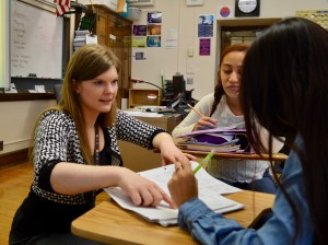 Washburn High School teacher Ashley Karlsson works with students during a world history class. Photo by Nate Gotlieb