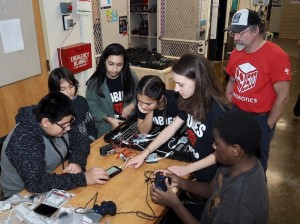 Rubies robotics team members (from left to right) Ava Kian, Izzie Mack and Rachel Springer assist members of a new Minneapolis robotics team. Photo courtesy Patrick Henry robotics
