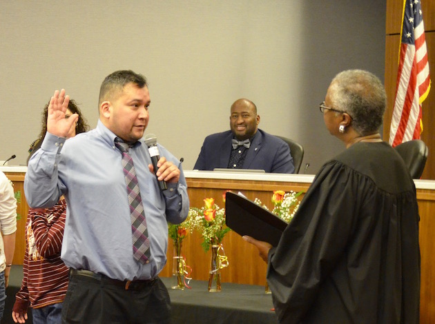 New School Board member Ira Jourdain takes the oath of office Tuesday. Photo by Nate Gotlieb