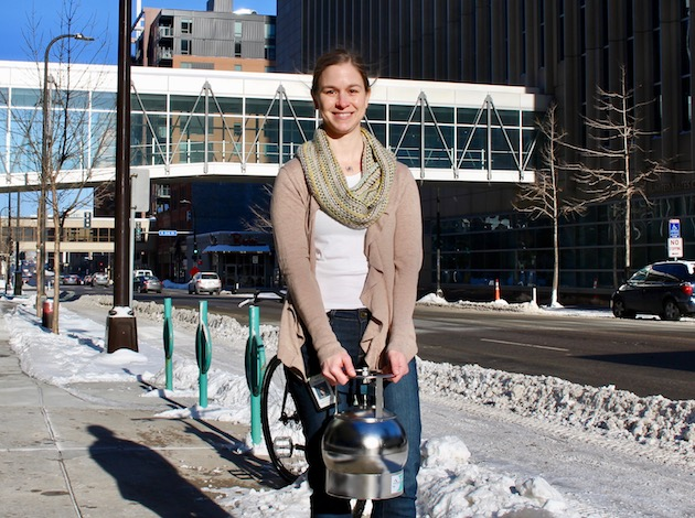Minneapolis senior environmental research analyst Jenni Lansing poses with a canister used to measure air quality in a recent study. Photo by Nate Gotlieb