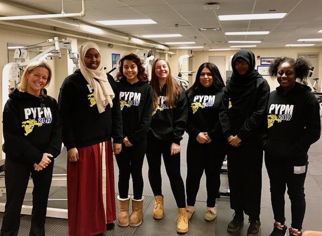 (From left to right) Edison health and fitness teacher Brenda Corbin smiles with Protecting You/Protecting Me mentors Anisa Ali, Bianey Ochoa, Victoria Simon, Maria Rios, Suadi Mohamud and Ze'Kiera Norwood. Photo by Nate Gotlieb