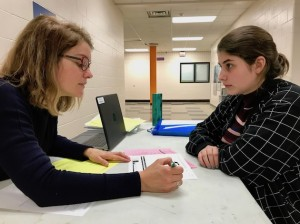 Washburn High School ninth-grader Anna Keefe meets with counselor Amy Webster to discuss her schedule for the 2017-18 school year. Photo by Nate Gotlieb