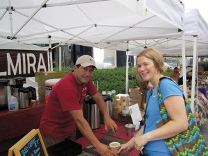 Carlos Palacio serves a coffee from his booth at the Mill City Farmers Market. Submitted photo