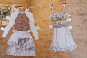 Two examples of Carmen Gutierrez-Bolger's paper doll dresses. Photo by Susan Schaefer