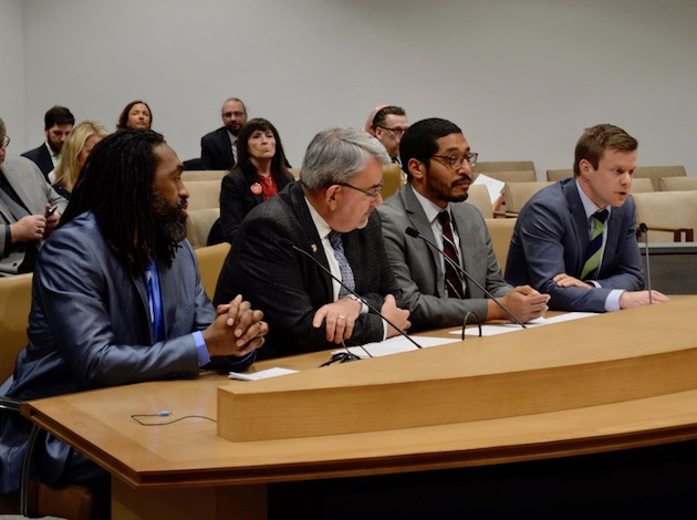 Minneapolis Public Schools Manager of Homeless and Highly Mobile Student Services Ryan Strack (far right) testifies in favor in a bill that would provide funds for homeless students and their families. Photo by Nate Gotlieb