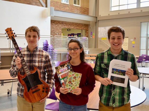 Southwest High School 10th-graders Ben Peterson, Hema Patel and Mark Pekala (from left to right) show off their personal projects they created as part of the school's Middle Years Programme. Photo by Nate Gotlieb
