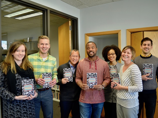 "Minnesota Comeback staff Kristen McKittrick, Nicholas Banovetz, Al Fan, Rashad Turner, Sagirah Shahid, Cay Kimbrell and David Whitney hold the organization's latest project, the ""Minnesota Schools Finder."" Photo by Nate Gotlieb"