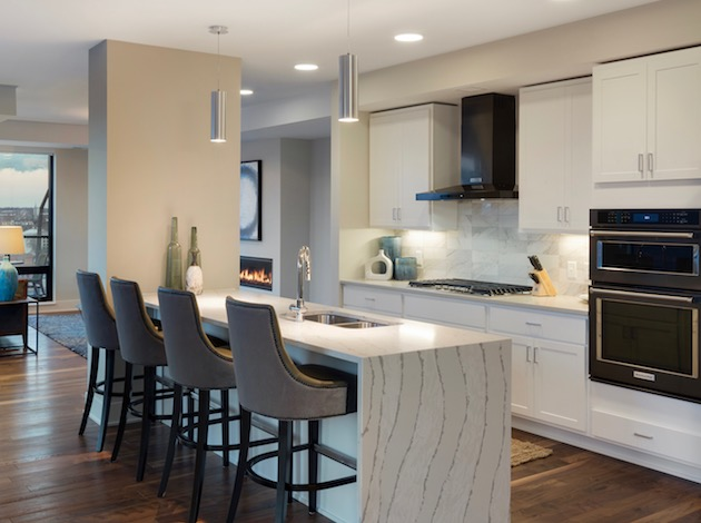The Encore luxury apartment building in the Mill District features condo finishes and condo-quality construction, according to DRG leasing director Patrick Carson.