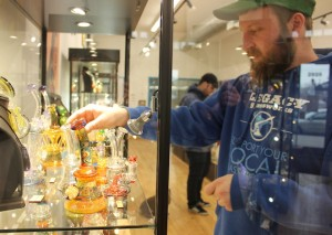 Owner Josh Wilken-Simon at the art gallery and tobacco shop Legacy Glassworks.
