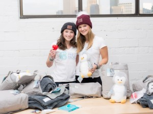 Pia Phillips (l) and Abbie Nelson, the teenage co-founders of PAB's PACKS, plan to give away 1,500 backpacks to chronically ill children this year. Submitted photo