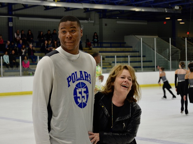 Marianne Yoshida smiles with North High junior Odell Wilson IV, whom Yoshida taught to skate as a young boy.