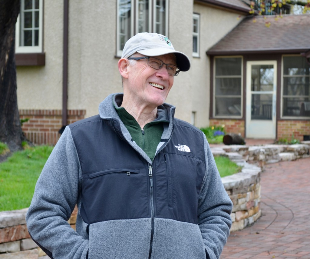 Friends of Diamond Lake board member Dave Oltmans shows off his driveway built of permeable pavers and his rain gardens.