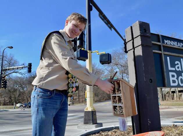"Boy Scout Eugene Tunney built and placed 10 ""bee hotels"" around Minneapolis in an effort to provide bees with space to forage. Photo by Nate Gotlieb"
