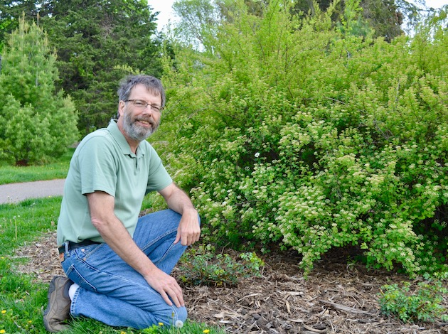 Kenwood resident Dave Schaenzer was honored by the Minneapolis Park & Recreation Board last month for his work caring for garden beds around Lake of the Isles. Photo by Nate Gotlieb