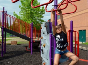 Eight-year-old Kennedy Robinson plays on the playground at Lucy Craft Laney Community School in North Minneapolis. The Minneapolis School Board is considering a proposal to mandate 30 minutes of recess daily at all elementary schools in the district. Photo by Nate Gotlieb