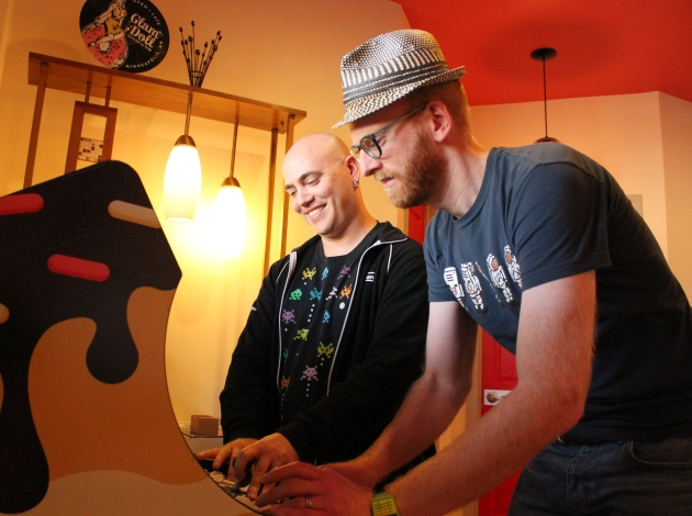 Martin Grider (l) and Zachary Johnson play the Donutron. Photo by Michelle Bruch
