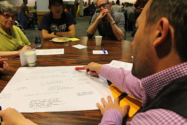 Deb Becker, Dan Yuan and Paul Soderquist looked on as James Dietrich spoke in their small-group discussion about the future of neighborhood organizations. They met at the first Neighborhoods 2020 Cafe event in April. Photo by Dylan Thomas
