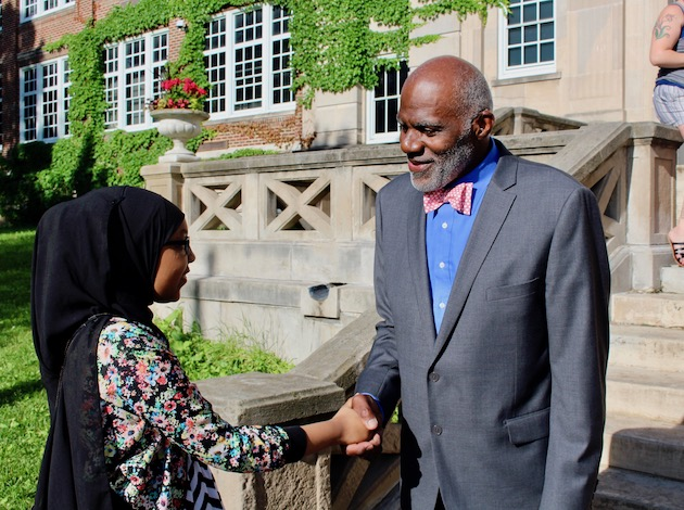 Alan Page shakes hands with a Justice Page Middle School student on June 14. Photo by Nate Gotlieb