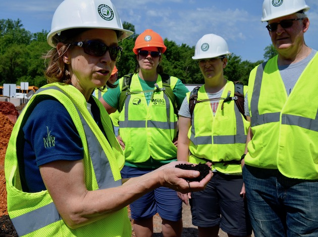 Anne Ludvik of Specialized Environmental Technologies explains the benefits of using compost to Minneapolis residents after a tour of the Rosemount composting facility on June 3. Photo by Nate Gotlieb