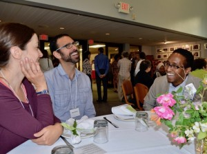 Shir Tikvah congregants Matt Belsky and Ariel Eason talk with Amiin Harun, a congregant of the Islamic Civic Society of America/Dar Al-Hijrah mosque on June 7 at a post-fast Ramadan dinner at the Lynnhurst synagogue. Muslims observe the monthlong holiday by fasting from sunrise to sunset each day. Photo by Nate Gotlieb