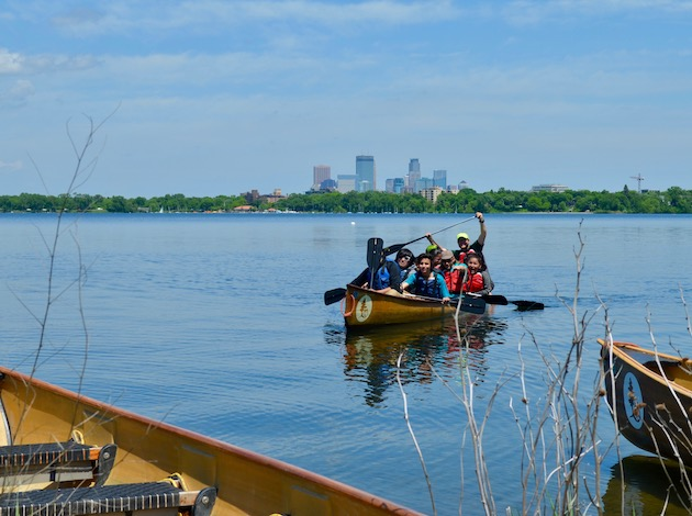 Minneapolis Public School students come to ashore after a canoe ride during the annual Mde Maka Ska event. Photo by Nate Gotlieb